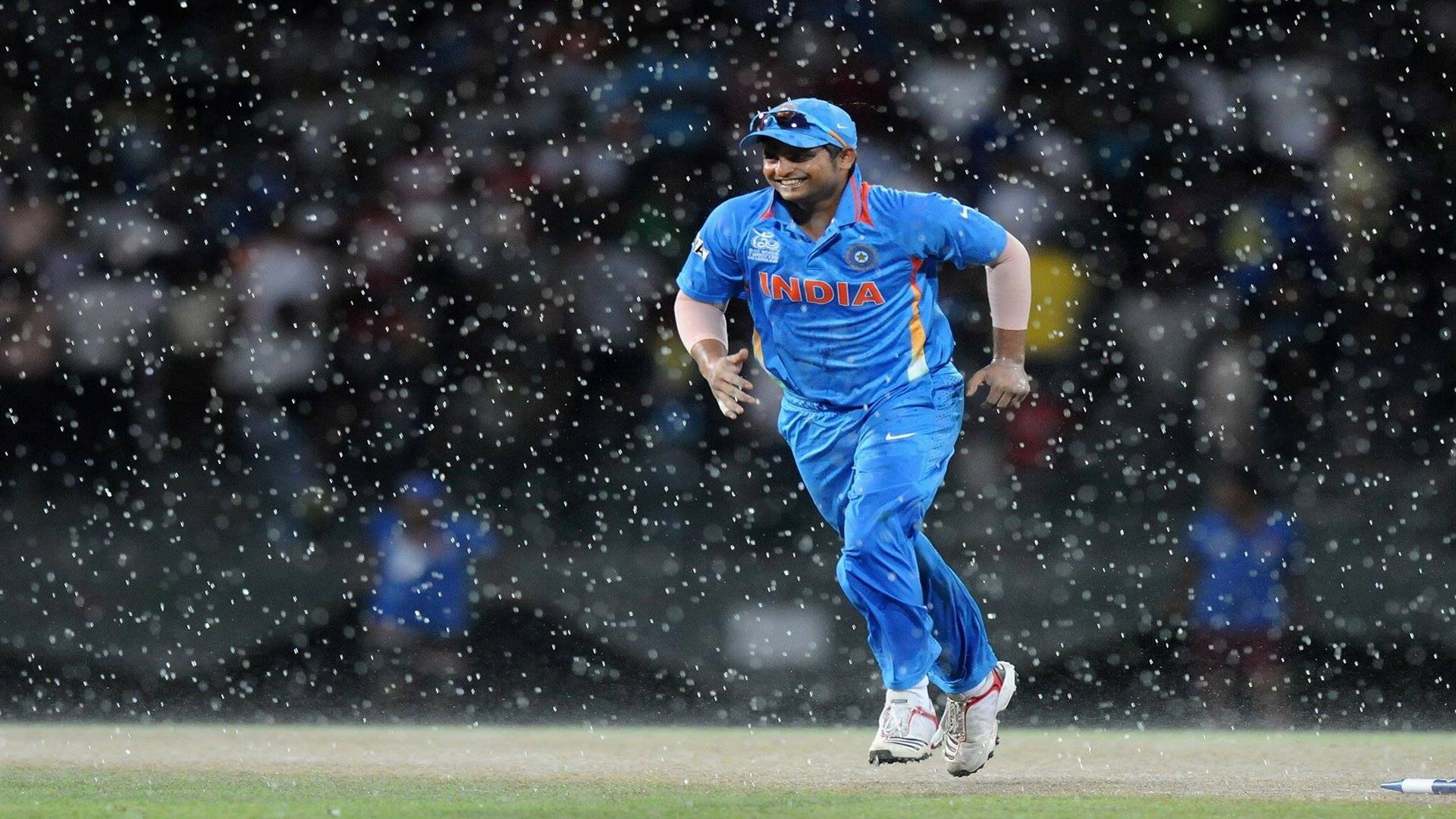 1920x1080 Suresh Raina Indian Batsman Criketer in Ground During Rain Wallpaper