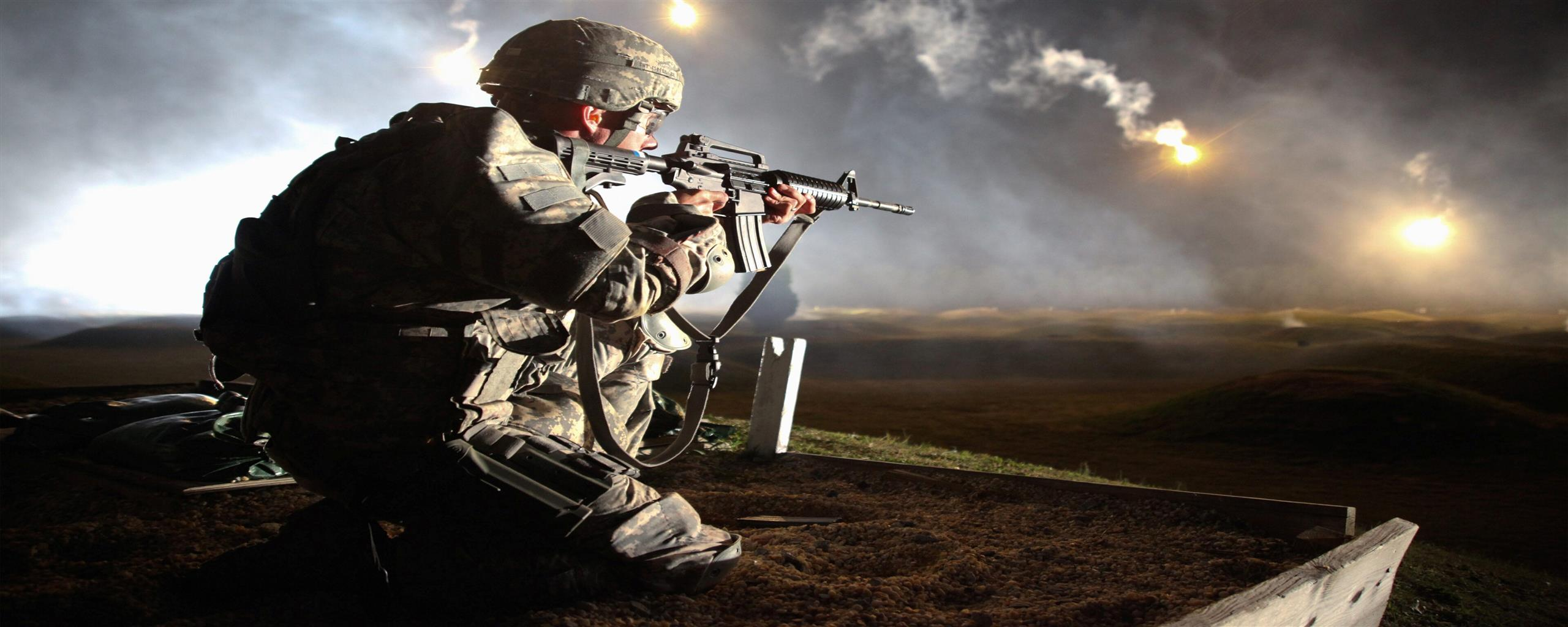 2560x1024 Army Soldier Petroling at Night Photo