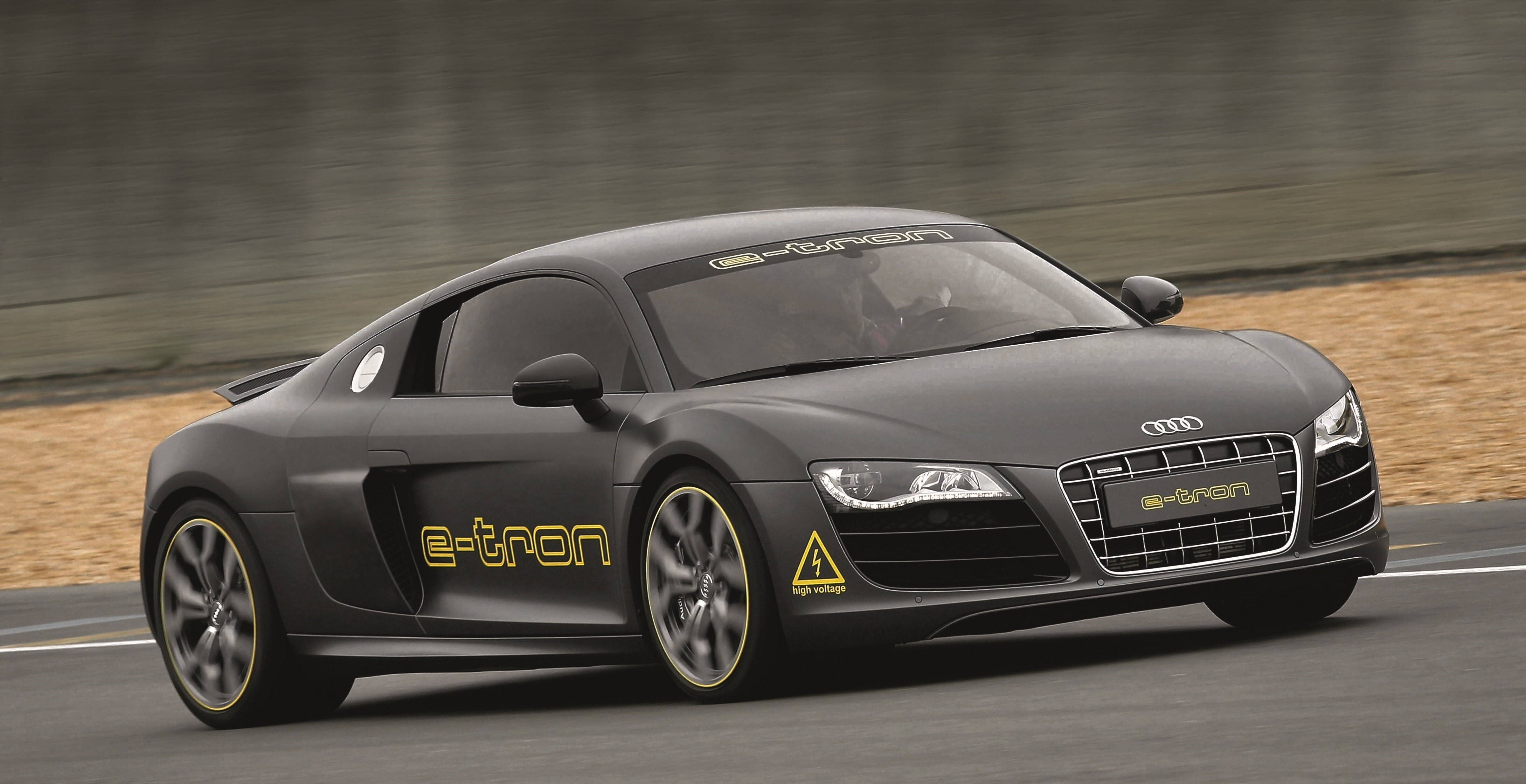 New_Latest_Model_of_Audi_R8_e_tron_Gray_Car_on_Road_Way_Wallpapers.jpg