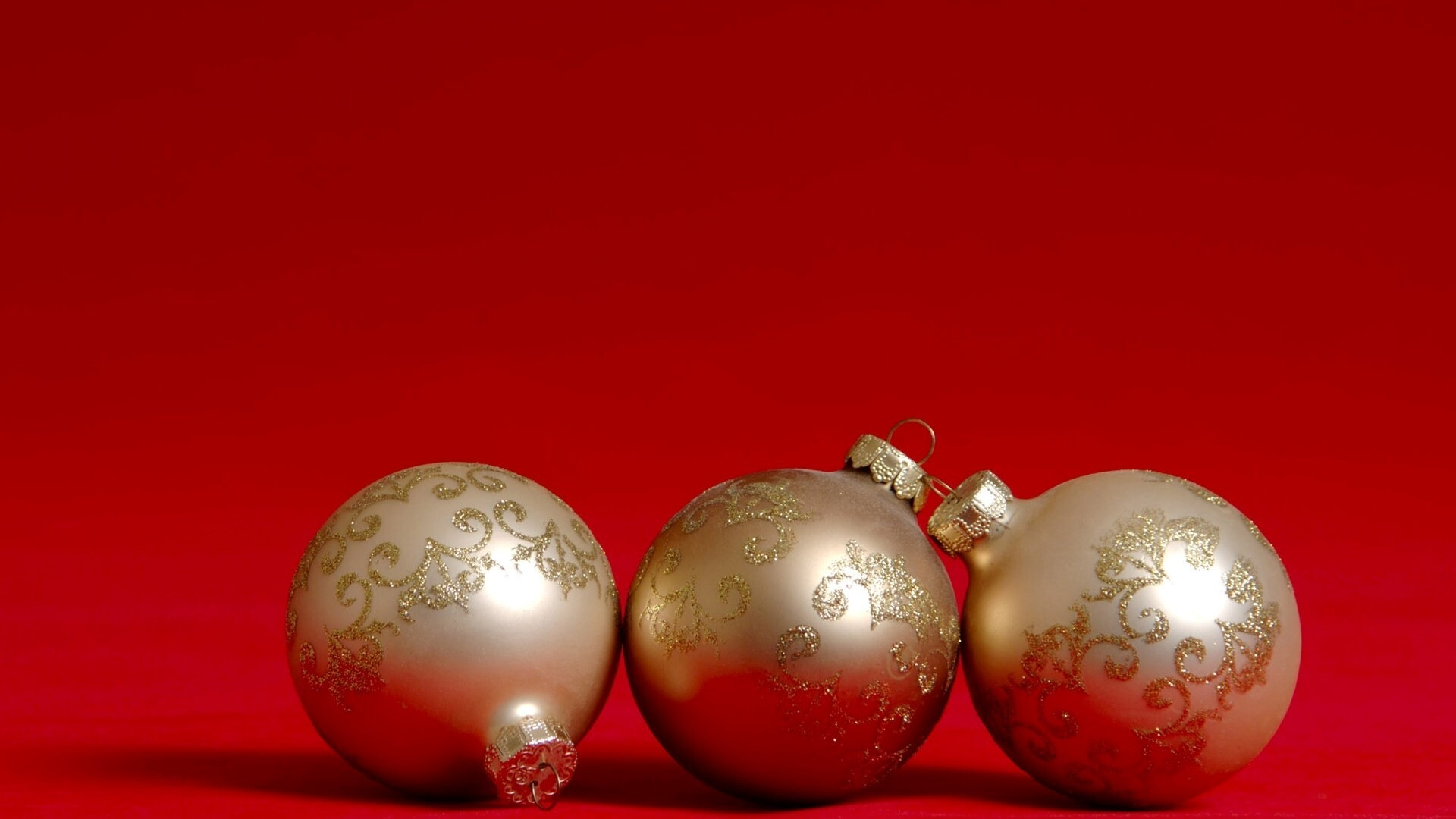 Beautiful Three Christmas Balls With Red Background Free