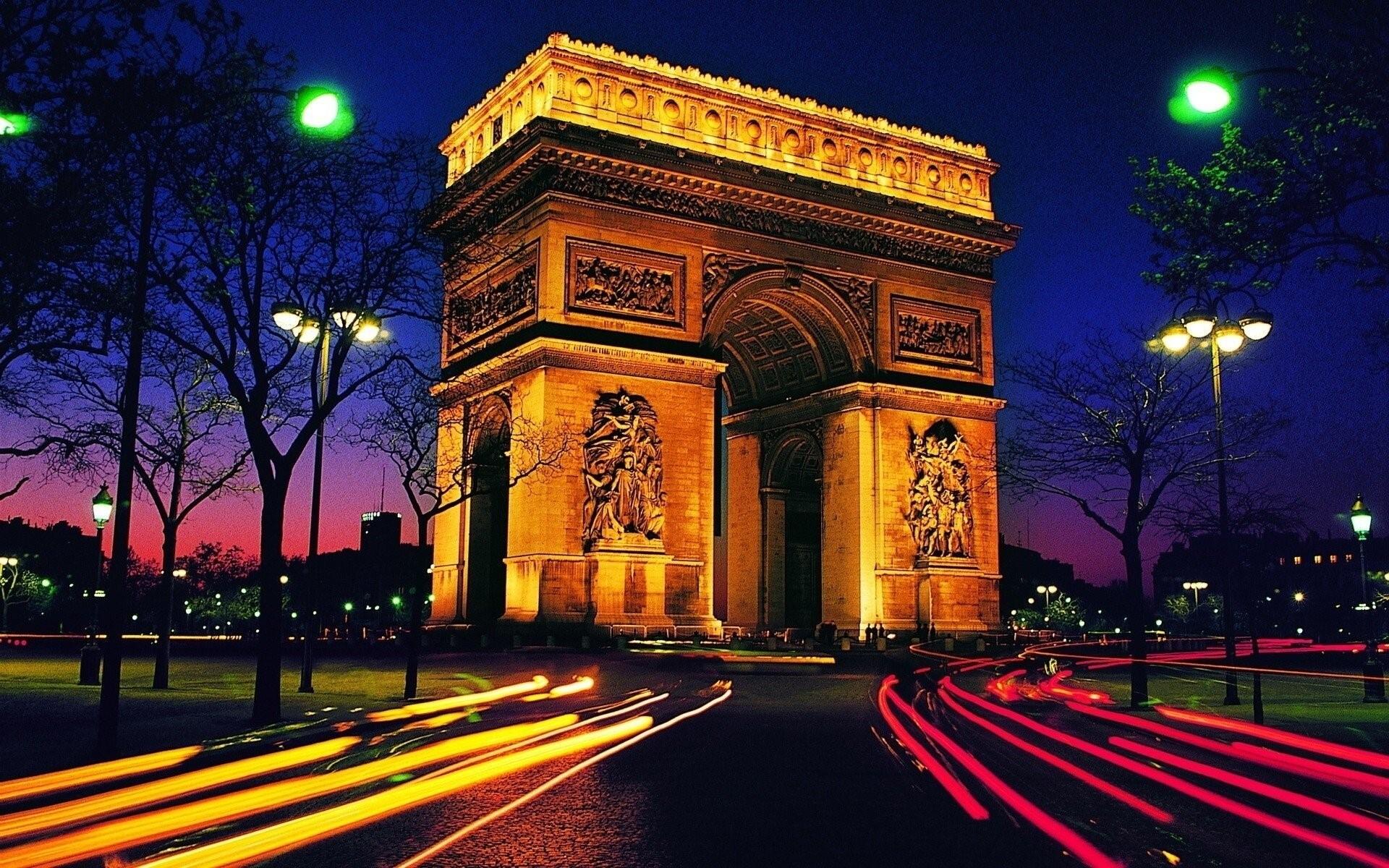 arc de triomphe at night tourist place in paris france wallpaper