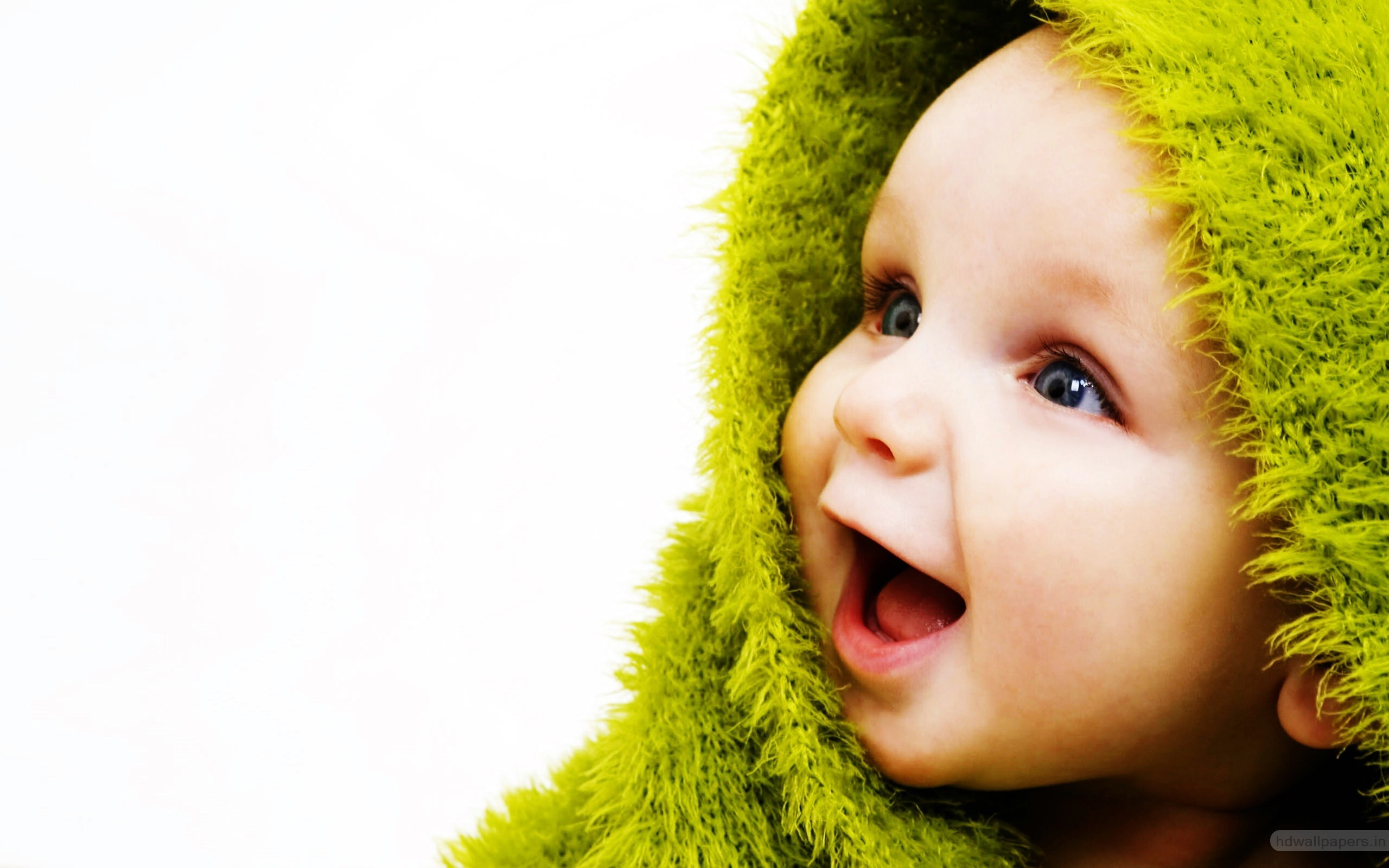 cute small baby with smile in green wallpapers hd wallpapers