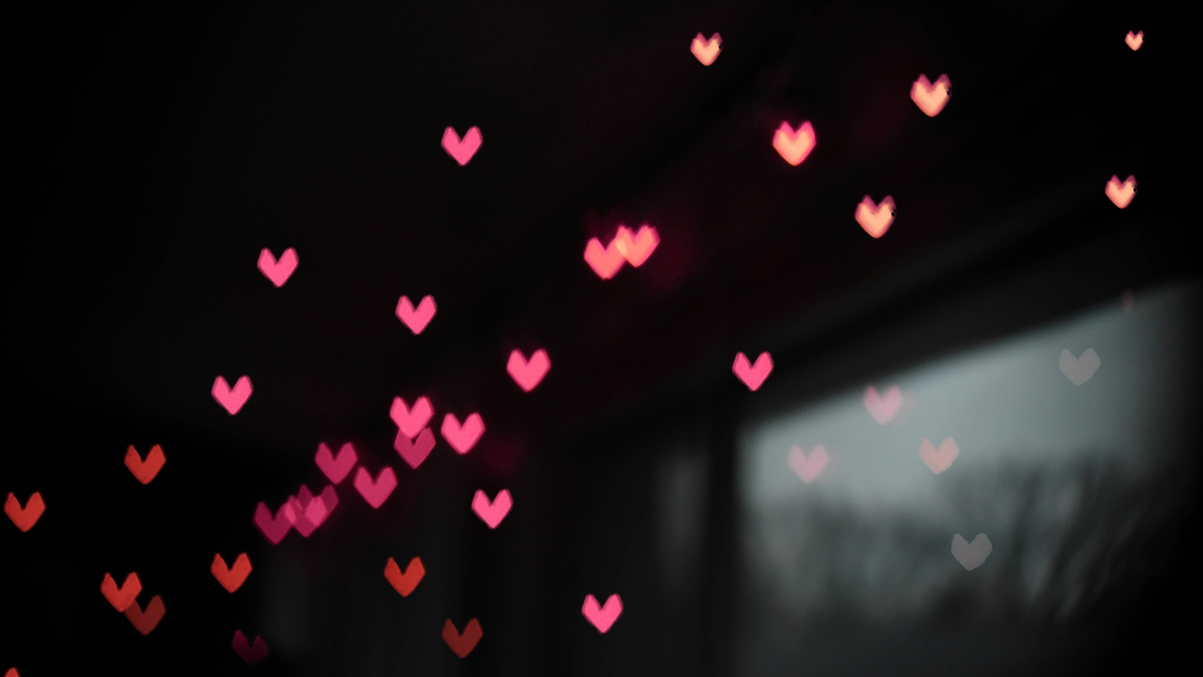 Small Pink Heart In Black Background 5K Abstract Wallpaper