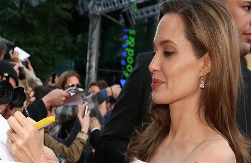 Popular American Hollywood Actress Angelina Jolie Give Autograph to Fans HD Wallpapers