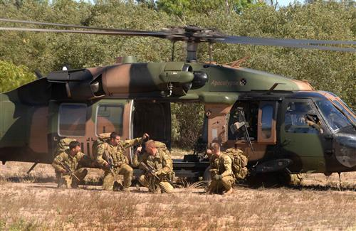 Forces Army Commando near Helicopter Images