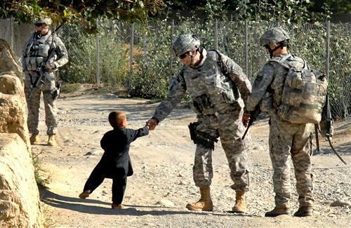 US Army Shake Hand with Little Boy