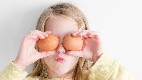 Beautiful Baby Girl Play with Egg 5K Wallpaper