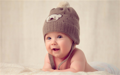 Cute Baby Boy in Winter Cap Wallpaper