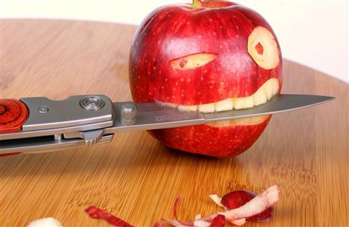 Apple with Knife Funny Wallpaper