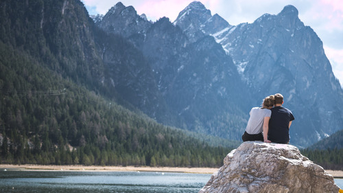 Couple Spend Good Times on Rock 4K Photo