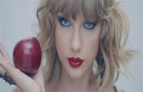 American Famous Singer Taylor Swift with Red Lips and Apple in Hand HD Wallpapers
