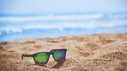 Sunglasses on Beach 5K Wallpapers