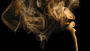 Orange Smoke Curling in Black Background Abstract 5K Wallpaper