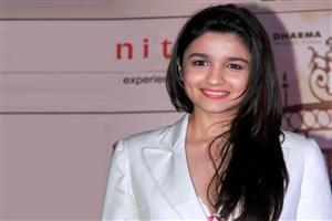 Alia Bhatt in White Coat with Red Lipstick