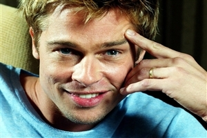 Brad Pitt Popular American Actor with Smile Wallpaper