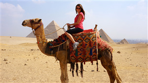 Tourist Lady Enjoy Camel Ride in Pyramids of Giza