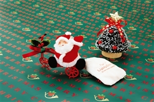 Santa Claus and Christmas Tree Gift in Merry Christmas