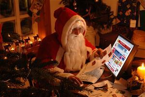 Santa Claus on Computer in Christmas Holidays Wallpaper