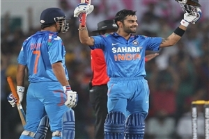 Mahendra Singh Dhoni and Virat Kohli after Make Century in Cricket Match Photos