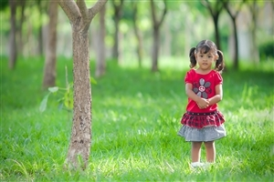 Beautiful Cute Little Girl Child Standing Silently in Garden Photos