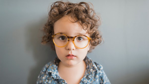 Charming Boy Wearing Glasses 4K Wallpaper