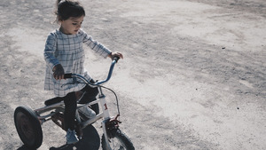 Child Play with Bicycle HD Pics