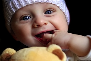 Cute Baby Child Playing with Doll Wallpaper