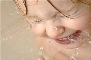 Cute Baby Playing with Water Wallpaper
