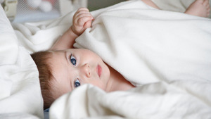 Cute Baby Sleeping with Blanket Wallpaper