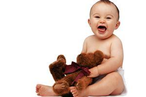 Cute Baby with Teddy and Smile