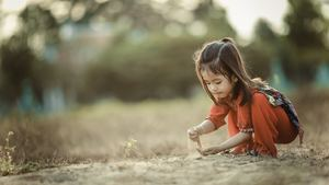 Cute Girl Child Playing with Sand Image