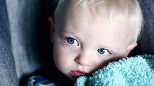 Delightful Baby Boy with Blue Eyes 5K Wallpaper