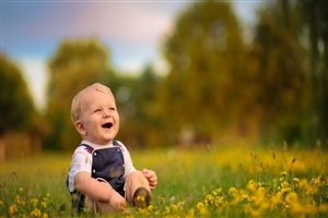 Smiling Beautiful Baby in Garden Photo