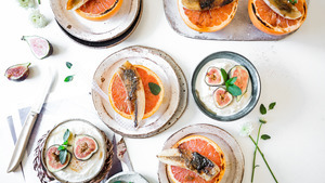 Fresh Grapefruit Topped with Nuts and Figs Breakfast Dish Photo
