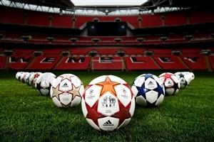 Footballs Row in Green Ground Sports High Quality Images