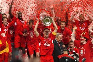 Steven Gerrard Celebrates with Winning Football Cup