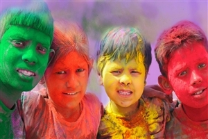 Children Celebrating and Playing Colorful Holi