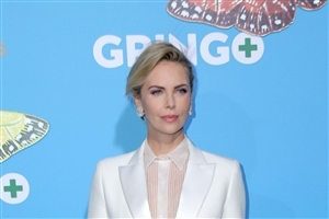 Charlize Theron in White Suite Actress Wallpaper