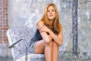Hollywood Actress Jennifer Aniston Sitting on Chair