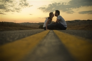 Cute Couple doing Romance on Road Wallpaper
