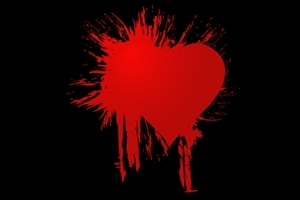 Red Heart on Black Background Photo