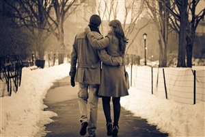 Romantic Couple Walk in Snowy Weather Wallpaper
