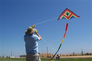 A Man Flying Kites
