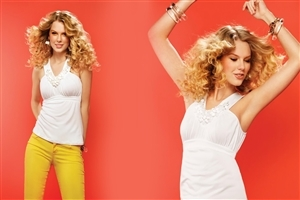 Singer Taylor Swift in Yellow Jeans with Nice Hairstyle Wallpapers