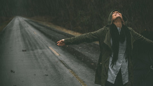 Girl Enjoying Rain on Street HD Wallpaper
