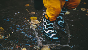 Kid Playing in Water During Rain 5K Wallpapers