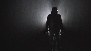 Shadow of Man at Night During Rain Photo