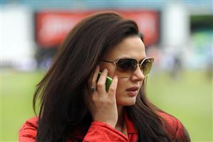 Beautiful Bollywood Actress Preity Zinta on Phone