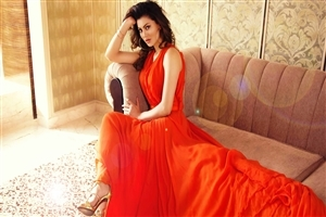 Urvashi Rautela in Orange Dress Wallpaper