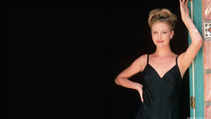Charlize Theron in Black Dress 4K Wallpaper